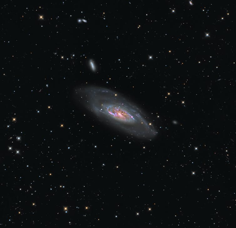 An image showing detail of one galaxy, but visually implying there are many more.