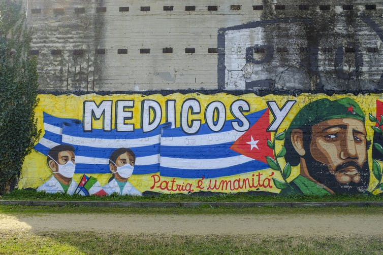 mural on a wall in Italy thanking Cuban doctors