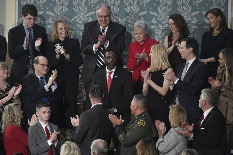 A man receives a standing ovation.