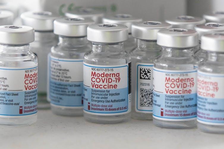 Empty vials of Moderna's COVID-19 vaccine
