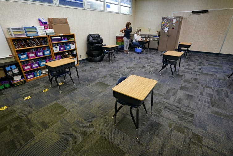 Desks spaced out in a classroom.