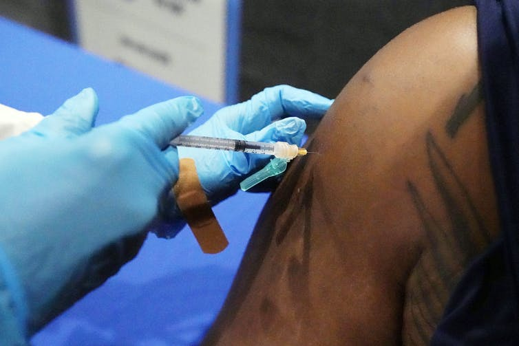 An arm getting an injection