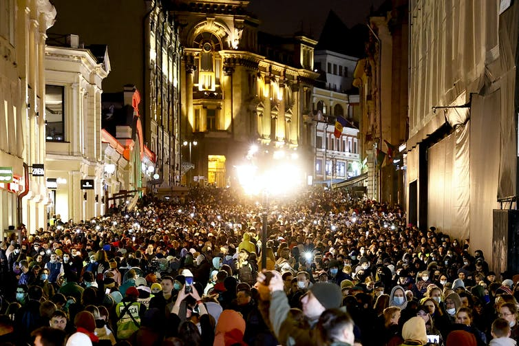 Huge crowd in a city street at night