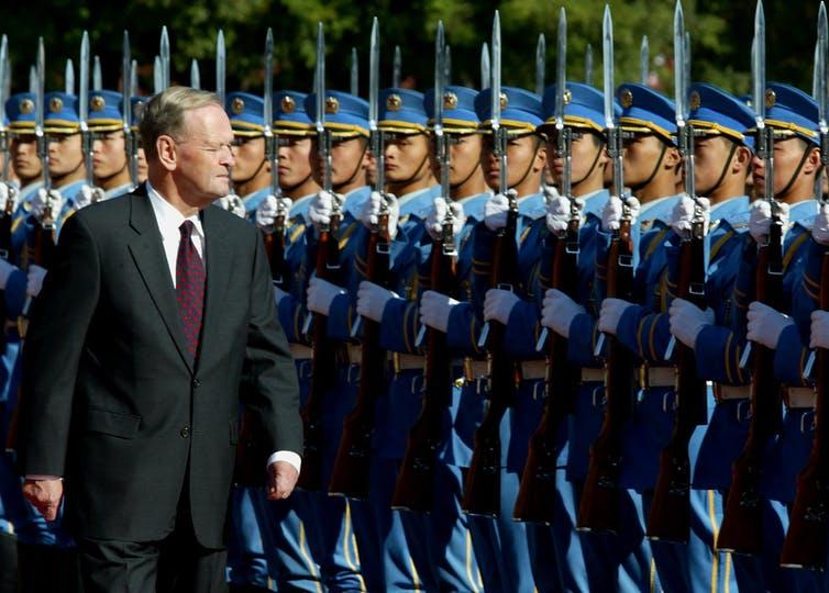 Chretien inspects the honour guard in Beijing.
