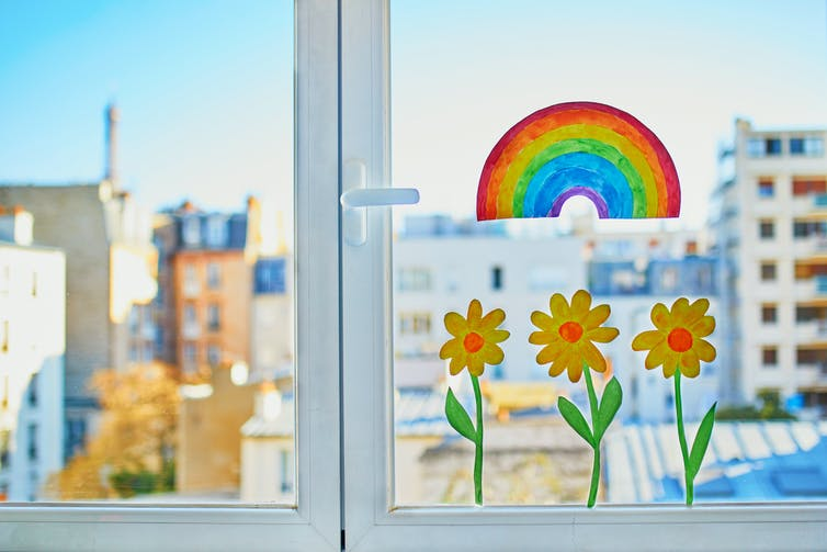 Drawings of flowers and rainbows in a window