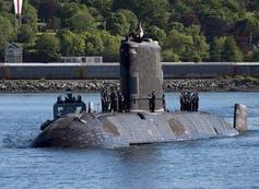 A submarine returns to port.