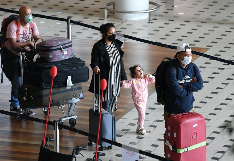 Passengers arrive in Brisbane in April 2020.