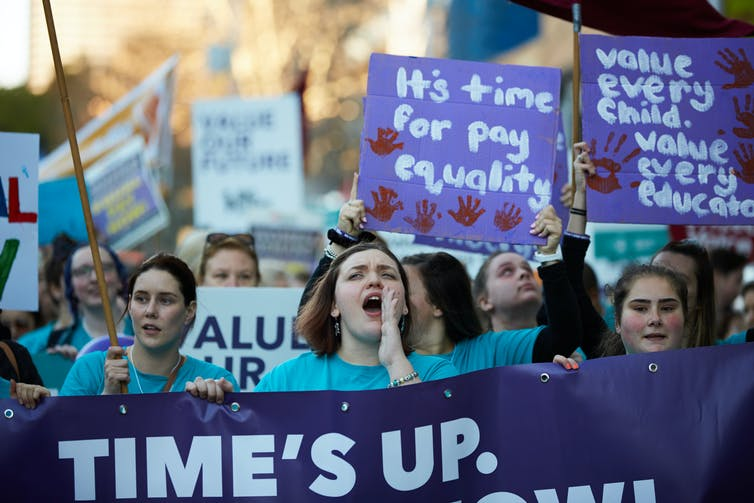 Protesters calling for equal pay.