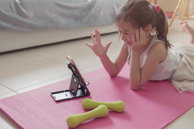 Young child talking to others on device.