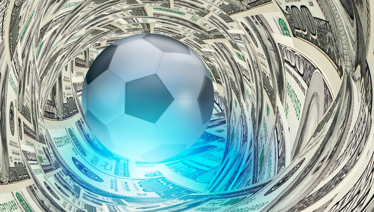 A football surrounded by dollar bills.
